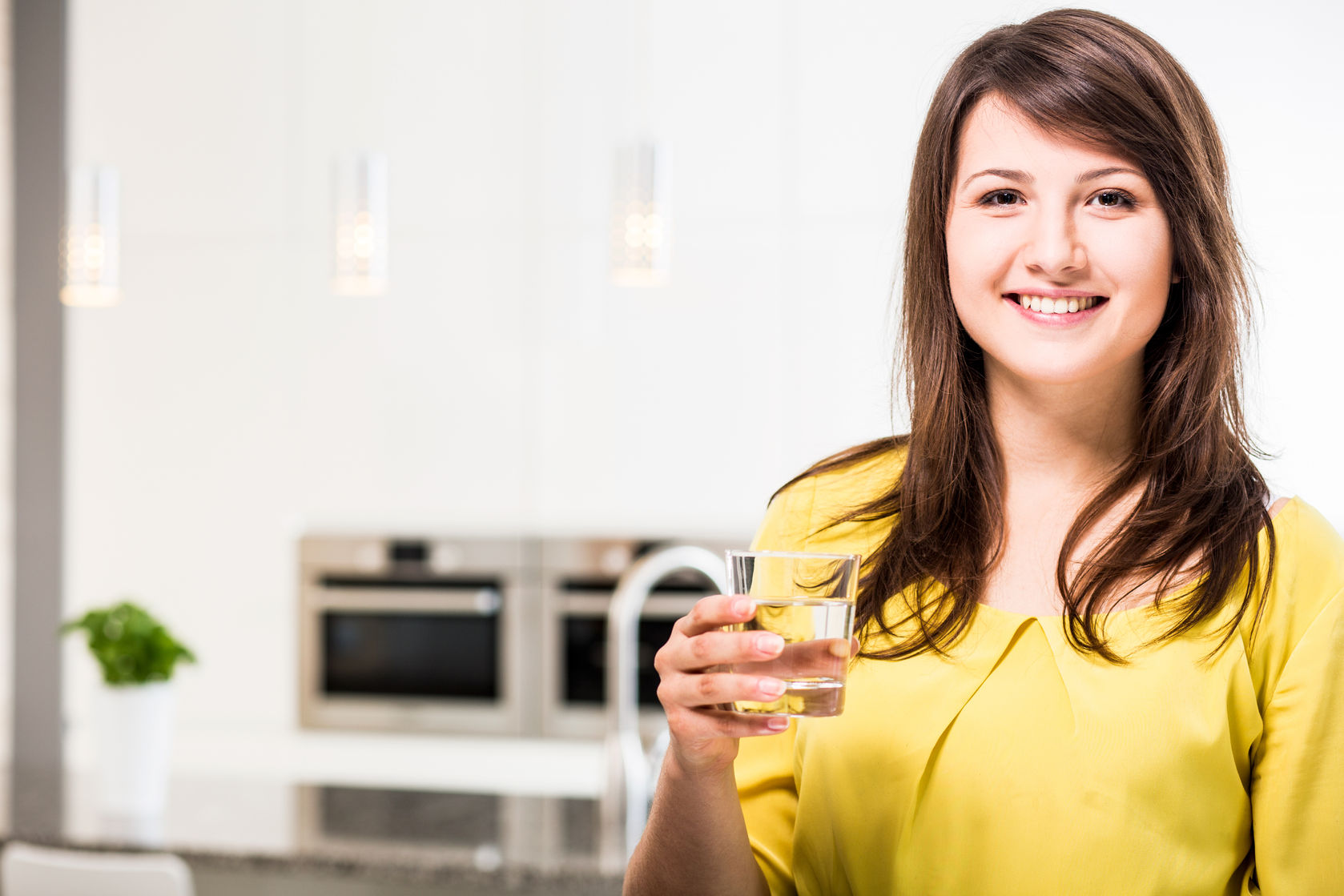 46990877 - young beauty woman with glass of water