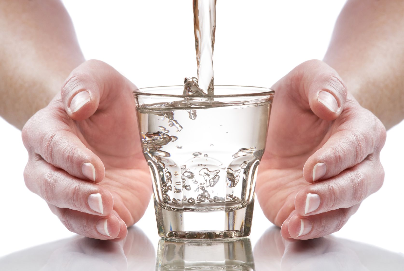 4552541 - glass of fresh water between hands close up